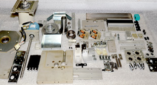 cut and clinch mechanism disassembled